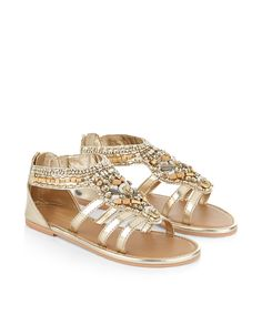 These metallic sandals for girls are embellished with clusters of beads and sequins, and designed with zip fastenings on the heels.  Softly-cushioned footbeds and flat, gripped soles provide a comfy fit.