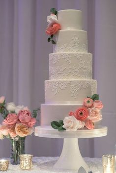 Featured Photographer: Cameron & Kelly Studio, Featured Cake: Heartsweet Cakes; Elegant five tier white wedding cake with subtle intricate lace detail