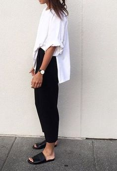 Oversized white shirt, cropped black trousers + black leather slides…
