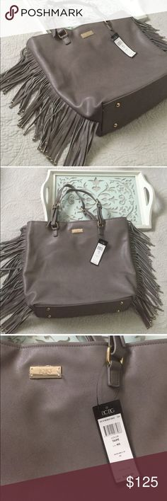 "Final reduction! {cp} BCBG NWT Taupe fringe tote Bag measure 15.5h X 16.5w X 4.5"". NWT $170  taupe faux/vegan leather w /1 inside zippered pocket and 2 small open pockets. Very deep. Adjustable straps (not measured)  fully lined. CA Reseller LIC # SR FHA 102-916017 $  Make Offers! See info  🤑 price firm SAVE 20% when you bundle 2+  🚙 All item ship From CA 3️⃣ FYI: items are posted on 3 other sites as well  📝 All items are Detailed-please read profile for more info  🚫 I do NOT hold items…"