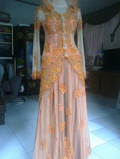 A pink and gold kebaya wedding dress! Lace and Gold-Thread!