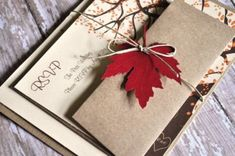Like the idea of including a real leaf with fall wedding invitations... I bet it would crush in the mail though :\