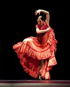 Spanish Flamenco dancer in beautiful orange dress