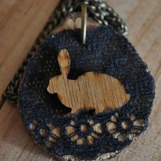 Wooden rabbit on lace on wood. 50cm chain.