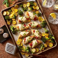 All on one pan! Oven baked chicken parmesan and roasted vegetables create a go-to weeknight dinner.