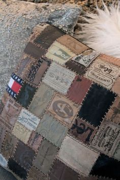 Labels off old blue jeans patch worked together to make a throw pillow cover