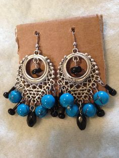 Cerulean blue and black handmade chandelier earrings.  www.etsy.com/shops/nealycreations