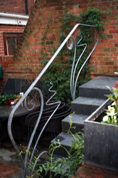 This Contemporary Art Nouveau Handrail was made and designed by Verdigris, a contemporary forge and metalworking studio. Iron Handrails, Wrought Iron Stair Railing, Steel Railing, Metal Stairs, Metal Railings, Wrought Iron Gates, Banisters, Porch Step Railing, Porch Steps