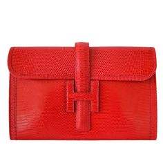 Hermès Jige Lizard Rouge Braise clutch Lizard Rouge Braise | From a collection of rare vintage clutches at https://www.1stdibs.com/fashion/handbags-purses-bags/clutches/