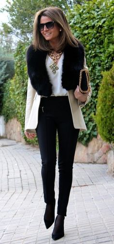 Gorgeous white coat with black faux fur teamed with black skinny pants and booties. Nice Fall/Winter office wear