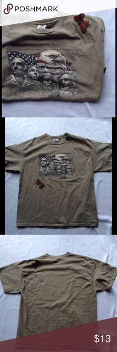 "Men's Short sleeve T Men's Mt. Rushmore short sleeve tee. Worn once no flaws. Greenish gray or khaki color. Measurements laying flat: Armpit-armpit 23"" Across back 21"" Sleeve length 8"" Across shoulders 22 1/2"" Neckline-hemline 27"" Delta Pro Weight Shirts Tees - Short Sleeve"