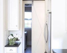 Modern Barn Door Hardware Kit Hangers Low Clearance Made in the USA Black or Raw Steel Finish You Choose Track Size