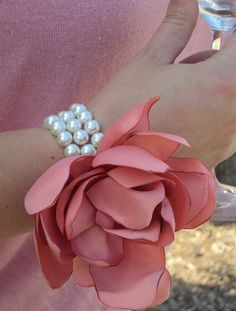 I like this idea for the mother's corsages. She can use the scraps from my wedding dress to make them too.