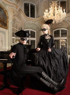 Black Gothic fashion period clothing costumes ~ LOVE the couple shot and the elegant background! Carnival Of Venice, Carnival Masks, Masquerade Costumes, Masquerade Ball, Masquerade Party Outfit, Halloween Costumes, Mode Sombre, Costume Venitien, The Frankenstein