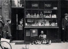The smallest shop in London, 1900. A shoe salesman with a 1.2 square metre shoe store.