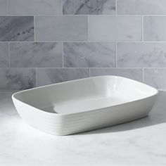 Crafted of durable, pure white porcelain, the Roulette baking dish has an attractive rounded rectangular shape accented with subtle concentric ripples. Designed by Martin Hunt of Queensberry Hunt, Roulette dinnerware has been a top-selling Crate and Barrel favorite since the pattern was introduced in 1992. Mix and match with our Roulette Blue Band dinnerware.