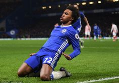 Willian leads the celebrations after his second goal of the match put Chelsea back into the lead against Stoke
