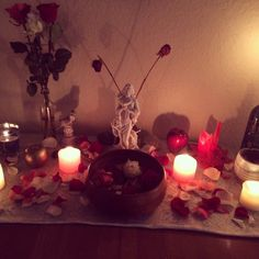 Aphrodite altar: roses (fresh, dried/drying, petals) + pink candles + statuette + bowl of water