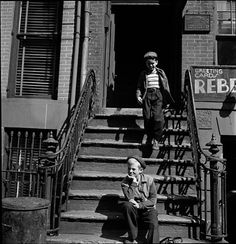 Shoe Shine Boy [Mickey and his friend on a stoop.]