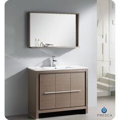 @Overstock - The Fresca 40-inch Allier is a sleek, modern free standing vanity with plenty of storage space. This set is accented nicely with a matching mirror with small shelf with a perfect balance of hues and textures.http://www.overstock.com/Home-Garden/Fresca-Allier-40-inch-Grey-Oak-Modern-Bathroom-Vanity-with-Mirror/7456464/product.html?CID=214117 $1,199.99