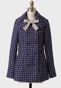 Doll Face Polka Dot Coat By Tulle $89.99 at #Ruche. Perfected with cream-toned polka dots, with darling double breasted navy coat features a statement collar and a removable velvet taupe bow. Finished with front button closures and front besom pockets. Fully lined.