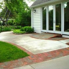 Lovely use of mixed materials and natural slope that means zero stairs.  Patio Space with wheelchair ramp repinned from @kimnterry