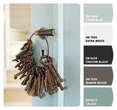 gray/tan/taupe exterior, black shutters, blue front door