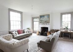 I love this house in Sussex. The white interiors are accented with French Gray Dark paint from The Little Greene Company. Furniture from I GiGi, a gorgeous shop