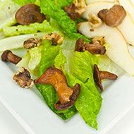 Grilled Wild Mushroom Salad with Black Walnut Vinaigrette: Add the woodsy flavor of fire-grilled chanterelle mushrooms and the sweetness of ripe pears, and you just might find that this is a salad to remember.