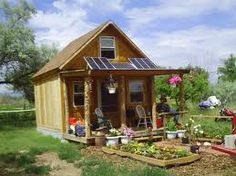 How to build a nice tiny cabin powered by solar panels.LaMar Alexander grew up in a homesteading family.For him, self-sufficiency, including gardening, raising Tiny Home Cost, Cheap Tiny House, Off Grid Cabin, Cabins And Cottages, Tiny Cabins, Tiny House Design, Cabins In The Woods, Little Houses, Small Houses