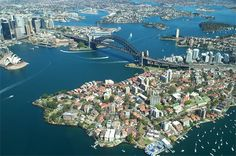 Spectacular aerial view of Sydney. Beautiful Kirribilli in the foreground (Sydney's north shore), The Opera House, Bridge and north end of the city on the south side (left of the picture). Circular Quay is just behind the Opera House - the main anchorage point in the Harbour for the first fleet. Everything 'grew up' from around this area - the rest is history.