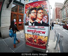 New York, USA. 17th Dec, 2014. Pedestrians walk past advertisement for #TheInterview a comedic film about North Korean leader Kim Jong-un's assassination. The planned premiere at the Landmark Sunshine Cinema was cancelled due to terrorist threats. © Richard Levine/Alamy Live News