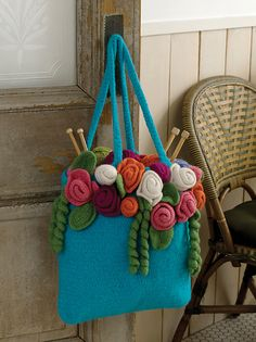 Ravelry: Rose Garden Tote pattern by Michele Wilcox.  I am SO going to make this, starting tonight!