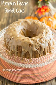 Pumpkin Pecan Bundt Cake with a Spiced Caramel Icing is a perfect fall flavor combination.