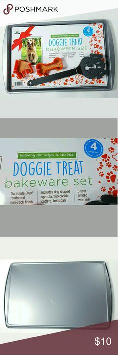 """Doggie Treat Bakeware 4 Piece Set Spatula 2 Dog Doggie Treat Bakeware 4 Piece Set Spatula 2 Dog Cookie Cutters Baking Pan DuraGlide Plus reinforced non-stick finish Includes dog shaped spatual, two cookie cutters, and treat pan (15.3"""" X 10.2"""") Featuring 2 recipes on the back 5 year limited warranty Other"""