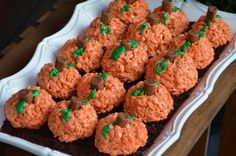 "Pumpkin Rice Krispies - make krispies as usual, add red & yellow food coloring and form into balls, add a Tootsie Roll ""stem"" and pipe some green leaves.....would make cute snacks for a school Halloween party!"