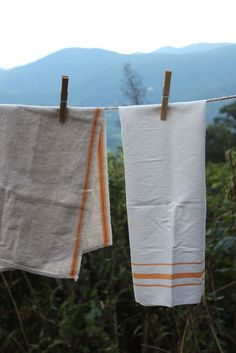 Three vintage linen tea towels for your home.
