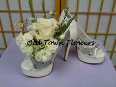 Want a unique centerpiece for the bridal shower? How about our Petals n pumps bouquets. 2 items a girl just loves shoes AND flowers!