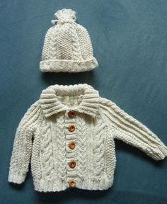 A baby boy's aran jacket and hat for the autumn