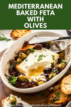 Learn how to make this delicious Baked Feta with Olives and Rosemary. A great last minute appetizer. #bakedfeta #bakedfetawitholives #fetarecipes  #cheeserecipes #easyrecipes #appetizerrecipes #itsnotcomplicatedrecipes  itsnotcomplicatedrecipes.com
