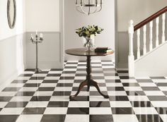 Polished white Viano and black Nero marble tiles forms a classic checkerboard floor here, for an elegant and chic finish. From Original Style's Earthworks collection: originalstyle.com.
