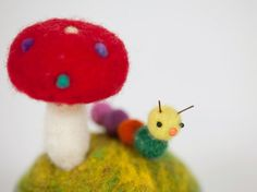 felted red toadstool and little caterpillar needle by HoneyCanada