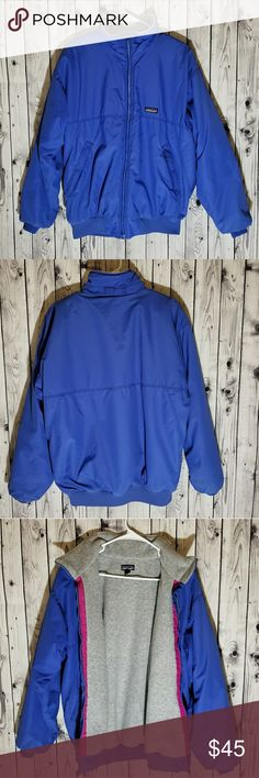 """Patagonia Vintage Blue Coat Bomber Fleece Lined Patagonia Blue Coat, size Large. Measures 26.5"""" from neckline to bottom of coat & 23"""" across the chest. Good condition, still durable with the following issues: small hole on bottom left of coat, does not go all the way through to the inside if the coat (pic #7 ); dark & White stain bottom right of coat (pic #8), dark stain on right sleeve (pic #9). I don't think stains are very noticeable. Patagonia Jackets & Coats"""