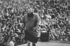 Action Bronson onstage, displaying a level of facial hair that we can frankly all aspire to.