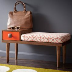 An interesting entry idea - a chair, a drawer for keys, somewhere to put your handbag.
