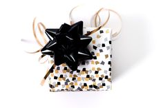 Our gold confetti gift wrap has a festive scattering of gold, silver and black confetti squares on a background of crisp white paper. Perfect for every occasion, this unique packaging will truly make