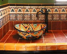 I love the colors of the tiles on this Mexican-inspired vanity and sink.