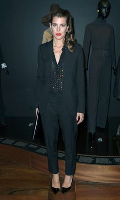 Charlotte Casiraghi kept her look simple in a black suit for the opening of the Yves Saint Laurent Museum opening party.     Photo: Getty Images