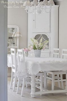 All white shabby chic dining room.