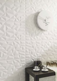 Your walls will never be boring again with the Pristine white textured wall tile by Porcelanosa. The Prisma tile is also available in amazing silver and bronze metallic finishes. Patterned Wall Tiles, White Tiles, Porcelanosa Tiles, Tiles Texture, Splashback, White Texture, Kitchenette, Apartment Ideas, Screens